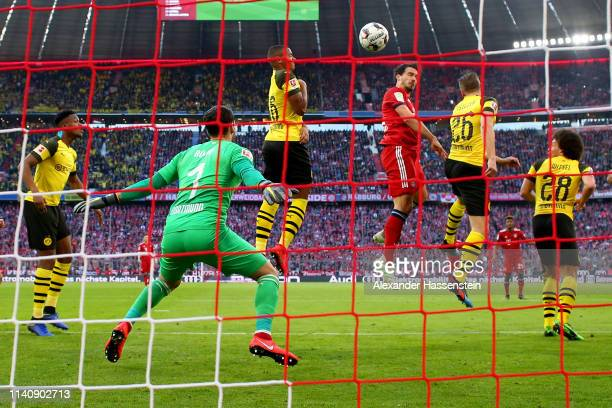 Mats Hummels of Muenchen scores the opening goal during the Bundesliga match between FC Bayern Muenchen and Borussia Dortmund at Allianz Arena on...