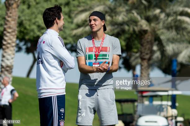 Mats Hummels of Muenchen speaks with Tennis player JanLennard Struff during the FC Bayern Muenchen training camp at Aspire Academy on January 04 2018...