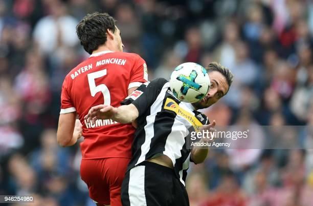 Mats Hummels of Munich and Josip Drmic of Borussia Monchengladbach vie for the ball during the German Bundesliga soccer match between FC Bayern...