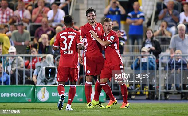 Mats Hummels of Munich celebrates after scoring the goal to make it 50 with teammates Joshua Kimmich and Julian Green during the DFB Cup match...