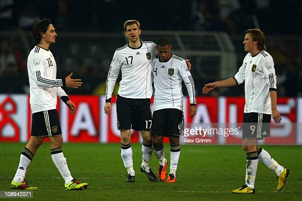 Mats Hummels Per Mertesacker Dennis Aogo and Kevin Grosskreutz react after the international friendly match between Germany and Italy at Signal Iduna...