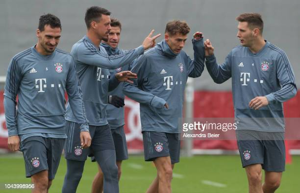 Mats Hummels Sandro Wagner Thomas Mueller Leon Goretzka and Niklas Suele of FC Bayern Muenchen joke during a training session at the club's Saebener...