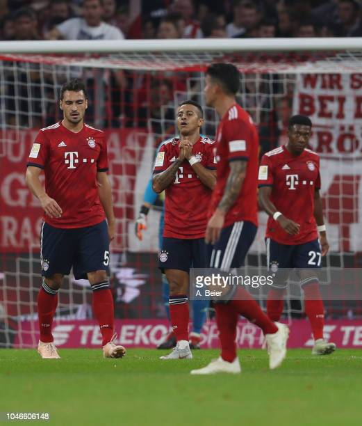 Mats Hummels Thiago James Rodriguez and David Alaba of FC Bayern Muenchen react after the second goal of Borussia Moenchengladbach during the...