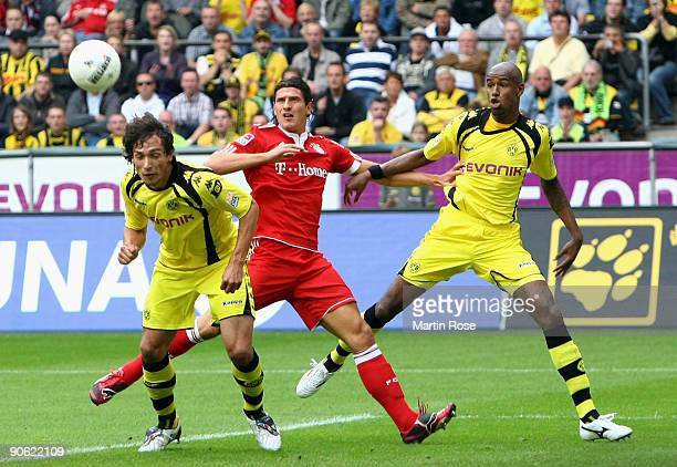 Mats Julian Hummels of Dortmund heads his team's first goal during the Bundesliga match between Borussia Dortmund and FC Bayern Muenchen at the...