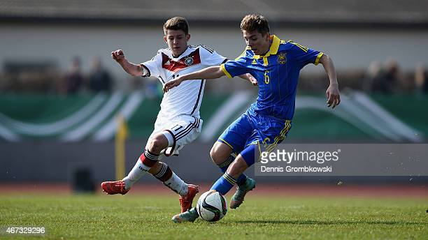 Mats Koehlert of Germany challenges Serhii Kosovskyi of Ukraine during the UEFA Under 17 Elite Round match between Germany and Ukraine at...