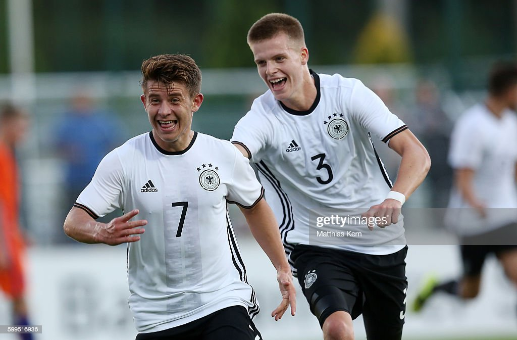 Mats Koehlert (L) of Germany jubilates with team mate Dzenis Burnic (R) after scoring the second goal during the international friendly match between U19 Germany and U19 Netherlands on September 5, 2016 in Luckenwalde, Germany.