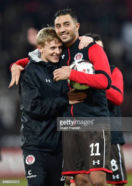 Mats M¿ller Daehli and Aziz Bouhaddouz of St Pauli celebrate after the Second Bundesliga match between FC St Pauli and Karlsruher SC at Millerntor...
