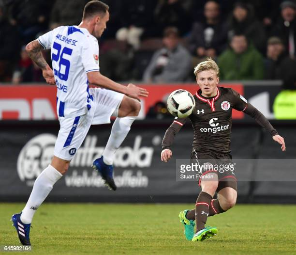 Mats M¿ller Daehli of St Pauli is challenged by Bjarne Thoelke of Karlsruher during the Second Bundesliga match between FC St Pauli and Karlsruher SC...