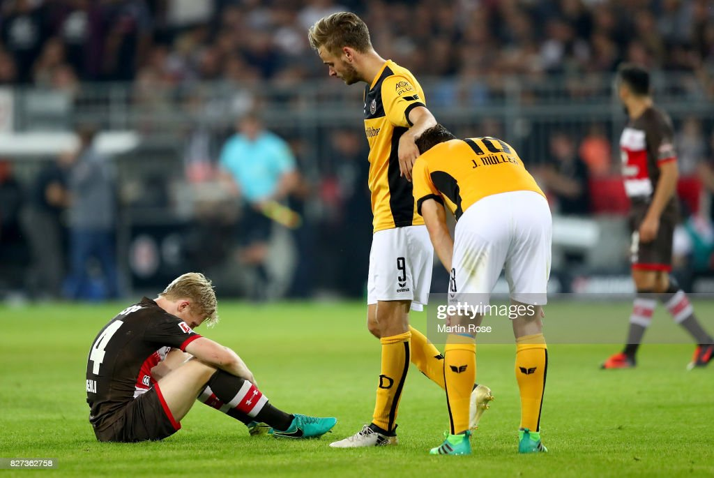 Mats Moeller Daehli of St. Pauli (L) reacts after the Second Bundesliga match between FC St. Pauli and SG Dynamo Dresden at Millerntor Stadium on August 7, 2017 in Hamburg, Germany.