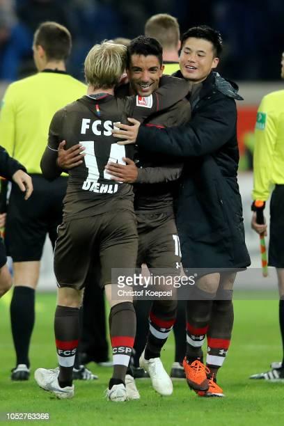 Mats Moeller Daehli Sami Allagui and Ryo Miyaichi of St Pauli celebrate winning 10 the Second Bundesliga match between MSV Duisburg and FC St Pauli...