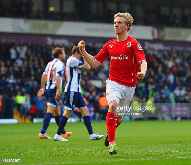 Mats Moller Daehli of Cardiff City celebrates scoring their third goal during the Barclays Premier League match between West Bromwich Albion and...