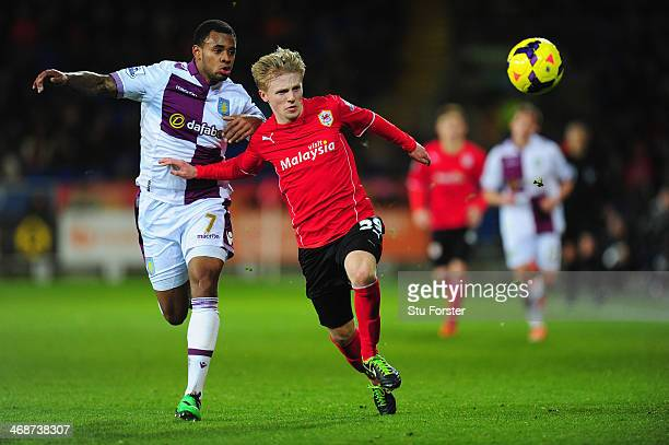 Mats MollerDaehli of Cardiff is challenged by Leandro Bacuna of Villa during the Barclays Premier League match between Cardiff City and Aston Villa...