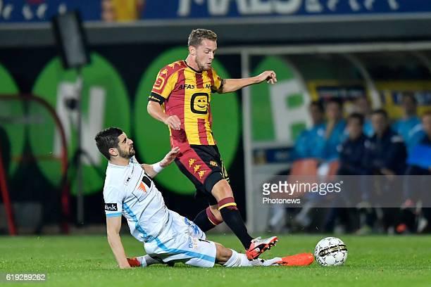 Mats Rits midfielder of KV Mechelen is tackled by Stefan Mitrovic defender of KAA Gent during the Jupiler Pro League match between KV Mechelen and...