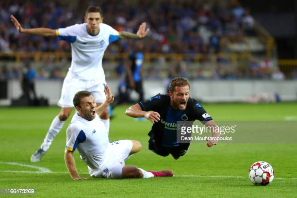 Mats Rits of Club Brugge KV is tackled and fould for a penalty by Oleksandr Karavayev of Football Club Dynamo Kyiv during the UEFA Champions League...