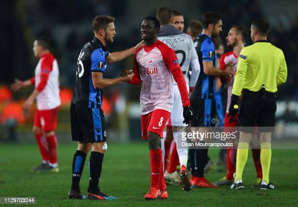 Mats Rits of Club Brugge shakes hands with Diadie Samassekou of FC Salzburg at the end of the UEFA Europa League Round of 32 First Leg match between...