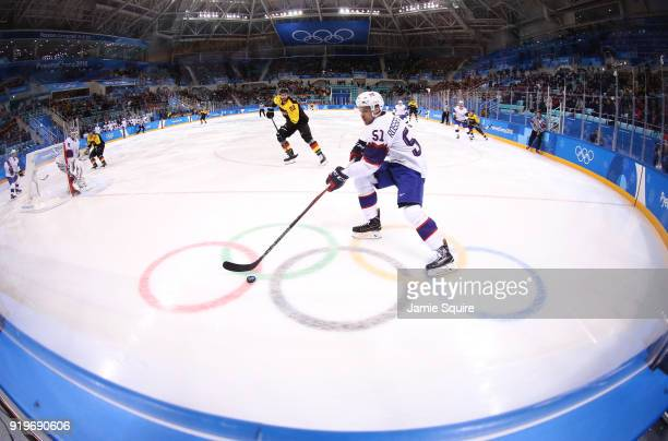 Mats Rosseli Olsen of Norway controls the puck against Germany in the first period during the Men's Ice Hockey Preliminary Round Group B game on day...