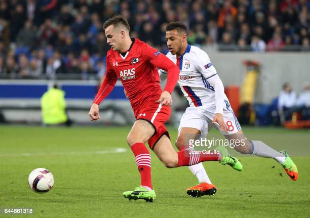 Mats Seuntjens of AZ Alkmaar and Corentin Tolisso of Lyon in action during the UEFA Europa League Round of 32 second leg match between Olympique...