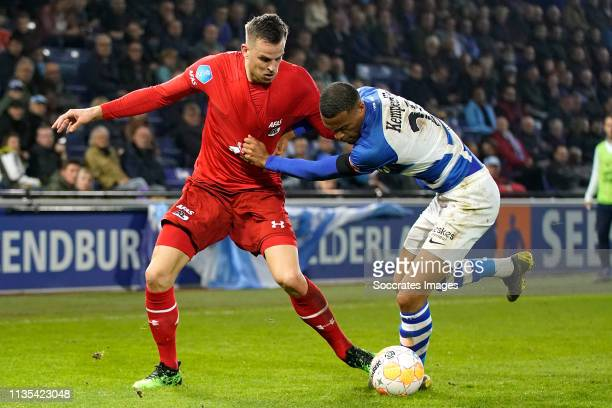 Mats Seuntjens of AZ Alkmaar Delano Burgzorg of De Graafschap during the Dutch Eredivisie match between De Graafschap v AZ Alkmaar at the De...