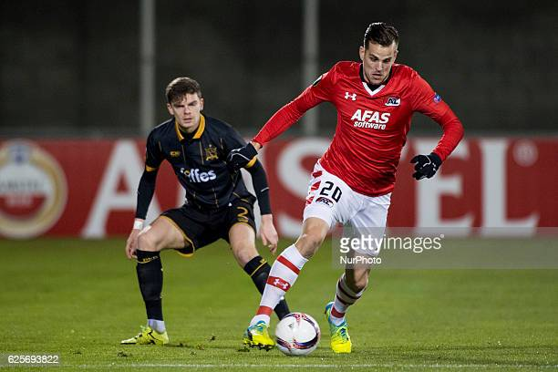 Mats Seuntjens of AZ fights for the ball with Sean Gannon of Dundalk during the UEFA Europa League Group D match between Dundalk FC and AZ Alkmaar at...