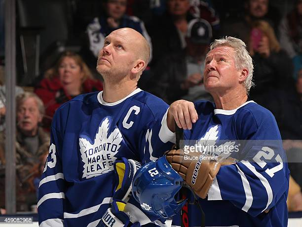 Mats Sundin and Darry Sittler watch the pregame ceremonies prior to the Hockey Hall of Fame Legends Classic Game at the Air Canada Centre on November...