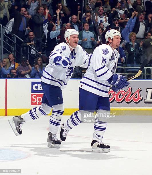 Mats Sundin and Lonny Bohonos of the Toronto Maple Leafs celebrate against the Buffalo Sabres during the 1999 NHL SemiFinal playoff game action at...