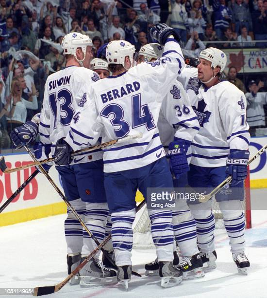 Mats Sundin Bryan Berard Dmitri Yushkevich and Lonny Bohonos of the Toronto Maple Leafs celebrate against the Pittsburgh Penguins during the 1999...