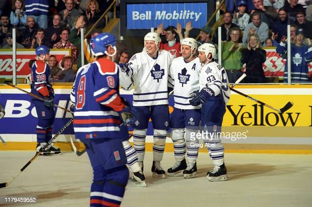 Mats Sundin, Dave Ellett and Doug Gilmour of the Toronto Maple Leafs skate against Zdeno Ciger and the Edmonton Oilers during NHL game action on...