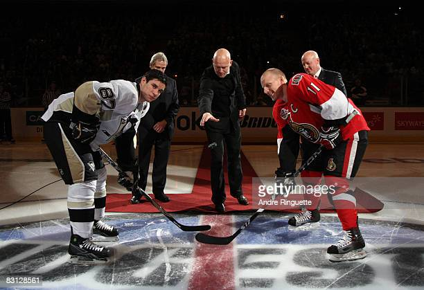 Mats Sundin drops the puck in a ceremonial faceoff with Daniel Alfredsson of the Ottawa Senators and Sidney Crosby the Pittsburgh Penguins at the NHL...
