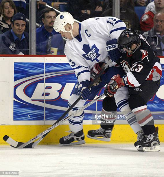 Mats Sundin of the Toronto Maple Leafs battles with Chris Drury of the Buffalo Sabres during a game at the HSBC Arena in Buffalo, New York, March 16,...