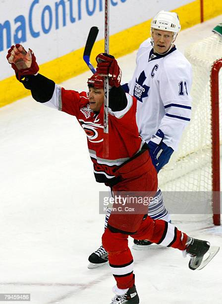 Mats Sundin of the Toronto Maple Leafs looks on as Rod Brind'Amour of the Carolina Hurricanes celebrates his game-winning goal during overtime at RBC...