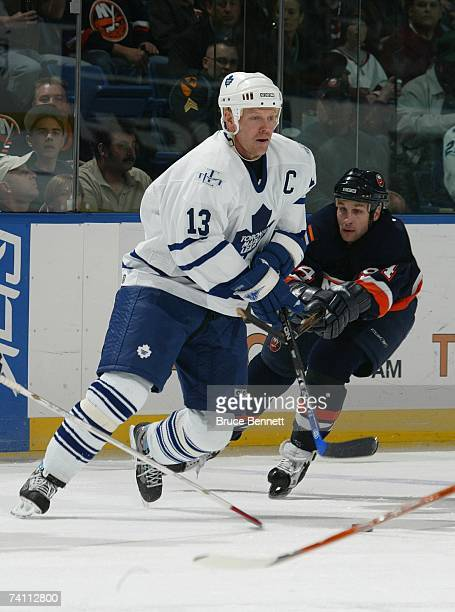 Mats Sundin of the Toronto Maple Leafs skates against Ryan Smyth of the New York Islanders on April 5, 2007 at Nassau Coliseum in Uniondale, New...