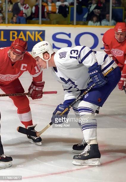 Mats Sundin of the Toronto Maple Leafs skates against Steve Yzerman of the Detroit Red Wings during NHL preseason game action on October 1, 1995 at...
