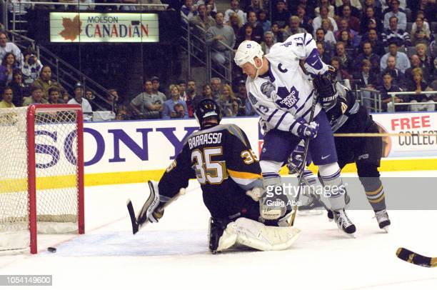 Mats Sundin of the Toronto Maple Leafs skates against Tom Barrasso and Brad Werenka of the Pittsburgh Penguins during the 1999 Quarter Finals of the...