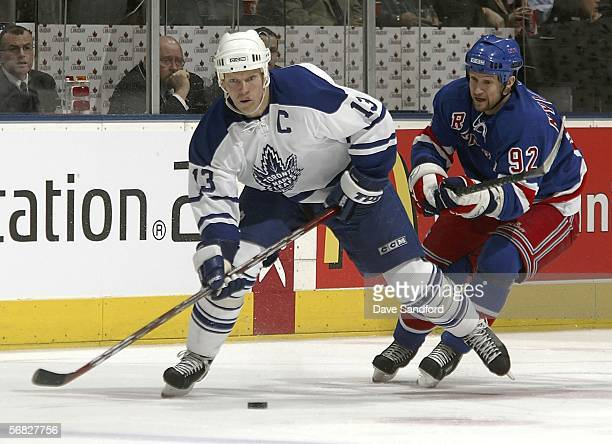 Mats Sundin of the Toronto Maple Leafs skates with the puck against Michael Nylander of the New York Rangers during their NHL game at the Air Canada...
