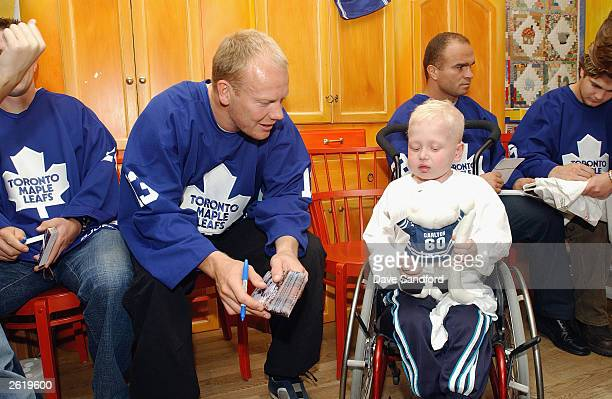 Mats Sundin of the Toronto Maple Leafs spends some time with a little boy at the Sick Kids hospital in Stockholm for NHL Challenge 2003 on September...