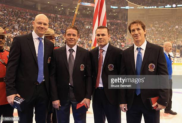Mats Sundin Pavel Bure Adam Oates and Joe Sakic are presented with Hall of Fame jackets prior to the Hockey Hall of Fame Legends Game at the Air...