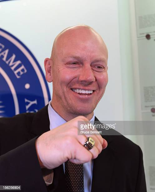 Mats Sundin poses with his Hall of Fame ring at the Hockey Hall of Fame ring ceremony on November 12 2012 in Toronto Canada Sundin and three other...