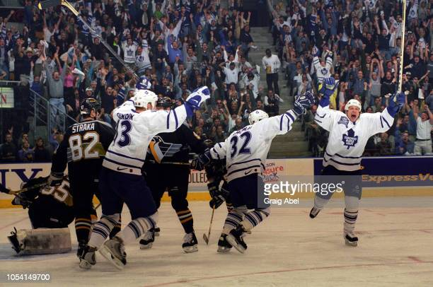 Mats Sundin Steve Thomas and Lonny Bohonos of the Toronto Maple Leafs celebrate against Tom Barrasso Martin Straka and Brad Werenka of the Pittsburgh...