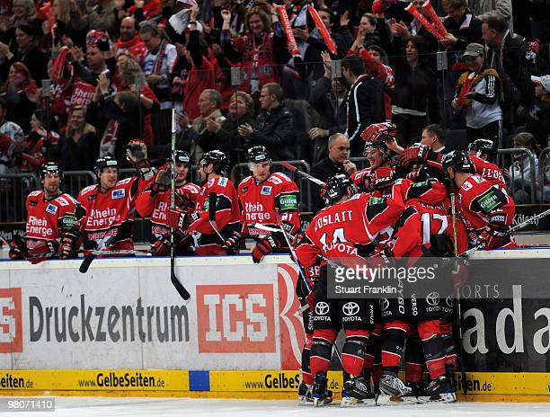Mats Tyrgg of Cologne celebrates scoring the second goal with teamates during the DEL playoff match between Koelner Haie and ERC Ingolstadt on March...