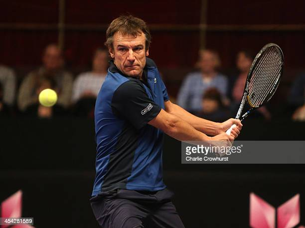 Mats Wilander looks to play a backhand during the singles final match between John McEnroe of the United States and Mats Wilander of Sweden on Day...