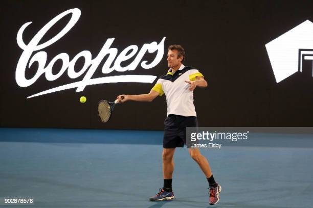 Mats Wilander of Sweden competes in his match against Robby Ginepri of the USA and Mansour Bahrami of Iran on day two of the 2018 World Tennis...