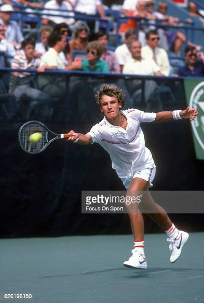 Mats Wilander of Sweden hits a return during the Men's 1983 US Open Tennis Championships circa 1983 at the USTA National Tennis Center in the Queens...