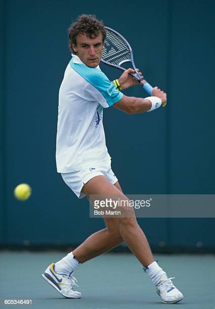 Mats Wilander of Sweden makes a double hand return during a Men's Singles match at the ATPLipton International Players Championship on 15 March 1988...