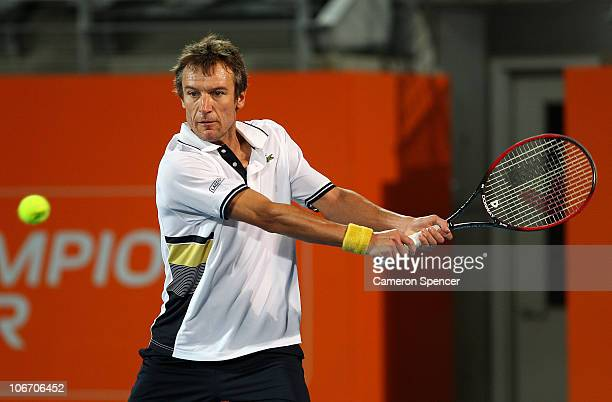 Mats Wilander of Sweden plays a backhand during his match against Pat Cash of Australia during day one of the Champions Downunder at Sydney Olympic...