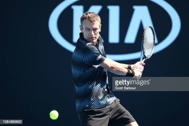 Mats Wilander of Sweden plays a backhand in his Men's Legends Doubles with Thomas Enqvist against Mansour Bahrami of Iran and Mark Philippoussis of...