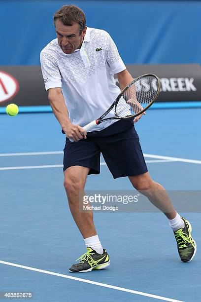 Mats Wilander of Sweden plays a backhand in his third round legends doubles match with Pat Cash of Australia against Yannick Noah of France and...