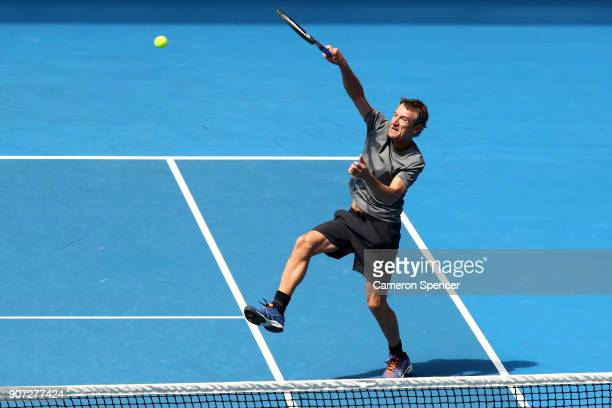 Mats Wilander of Sweden plays a forehand smash in his legend's match with Thomas Johansson of Sweden against John McEnroe of the United States and...