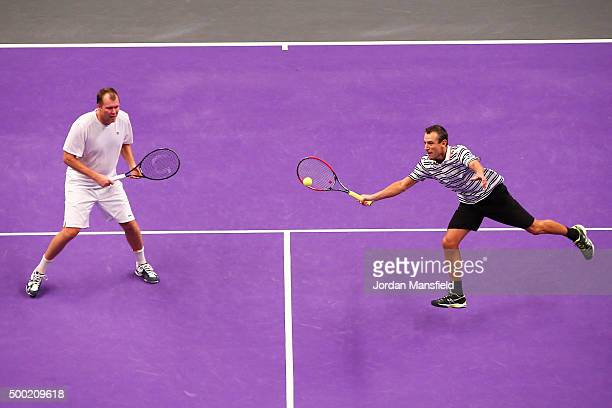 Mats Wilander of Sweden reaches for a ball while partnering Magnus Larsson of Sweden during their doubles match against Pat Cash of Australia and...