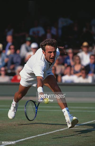 Mats Wilander of Sweden reaches for the return against Jacco Eltingh during their Men's Singles Third Round match of the Wimbledon Lawn Tennis...