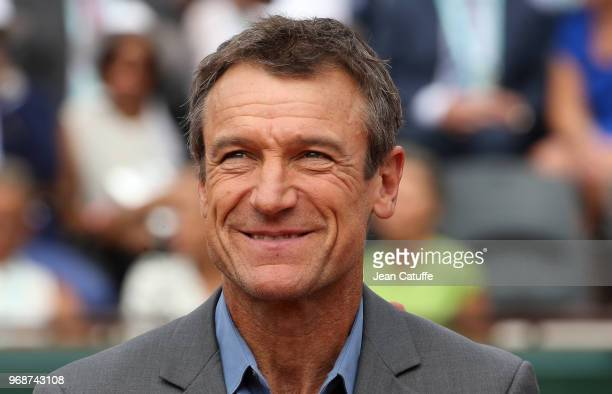 Mats Wilander receives on court a trophy for his 3 titles at the French Open during Day 11 of the 2018 French Open at Roland Garros stadium on June 6...